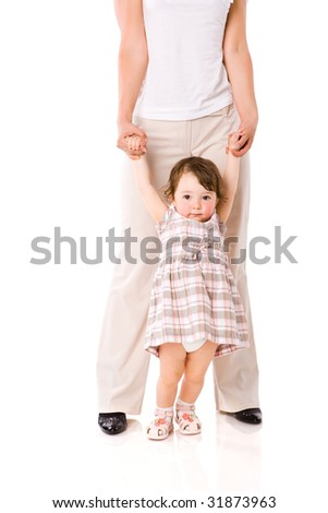 Mother holding daughter's hands isolated on white