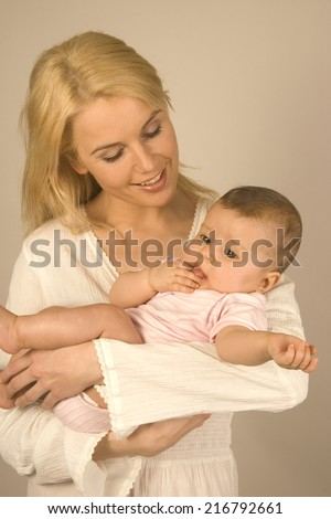 Mother holding her baby. - stock photo