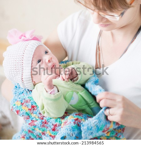 mother holding  her baby girl - stock photo