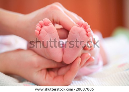 Mother holding her child's feet