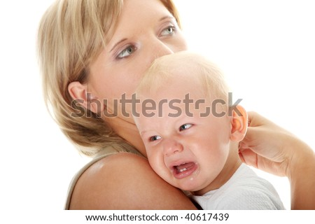 Mother holding her crying baby isolated on white background - stock photo