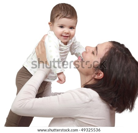 Mother holding her cute baby - stock photo