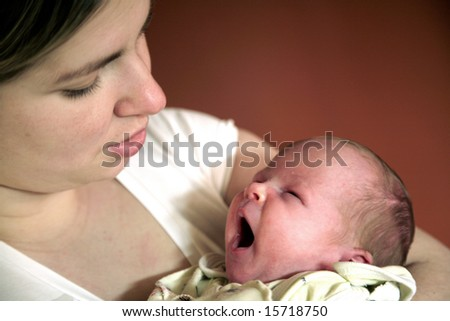 Mother holding her cute newborn baby