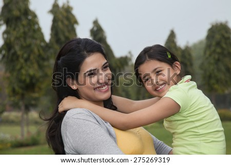 Mother holding her daughter - stock photo