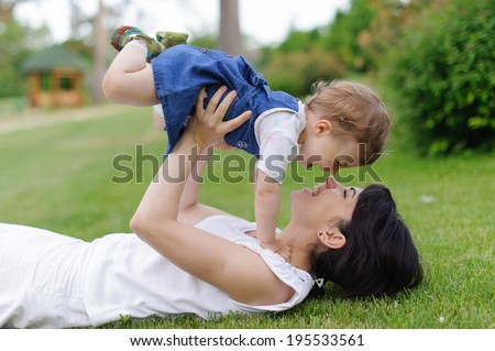 mother holding her happy laughing child - stock photo