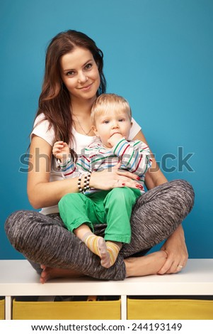 Mother holding her son - stock photo