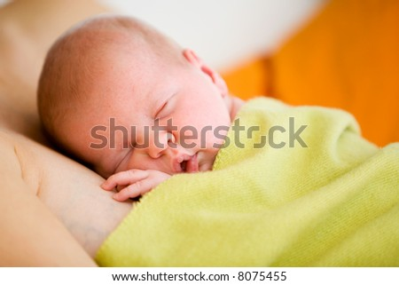 Mother holding sleeping baby girl