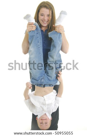Mother holding son by feet isolated on white. - stock photo