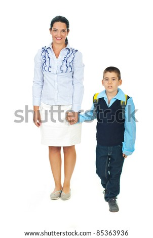 Mother holding son hand,talking  and going together in first day of school - stock photo