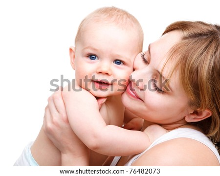 Mother holding sweet baby boy - stock photo