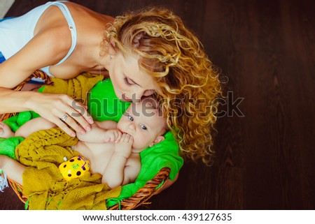 mother holding the hand of her  son - stock photo
