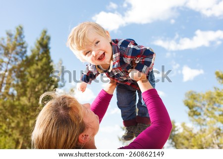 Mother Holding Up Her Child - stock photo