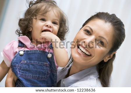Mother holding young girl conceived by IVF treatment - stock photo
