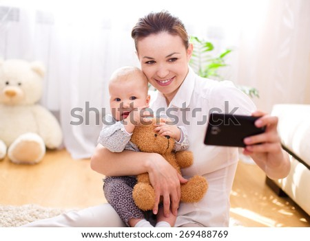 Mother holds cute baby - stock photo