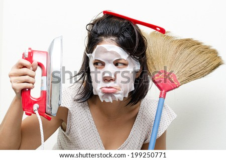 Mother housewife busy on house work - stock photo