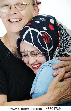 Mother hugging daughter - stock photo
