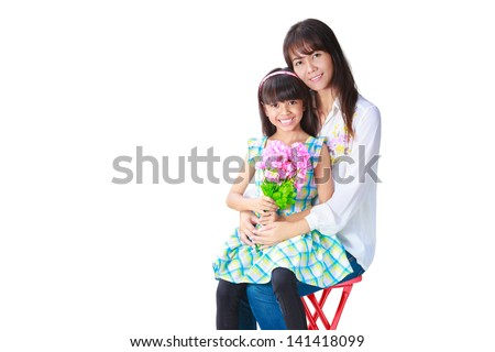 Mother hugging her daughter that have presented her the bunch of flowers, Isolated on white - stock photo