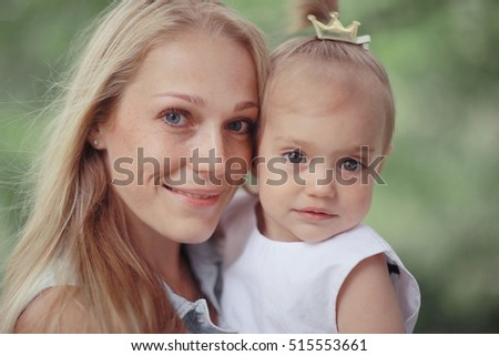 Mother hugging little daughter portrait