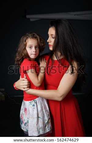 Mother hugs her crying daughter - stock photo