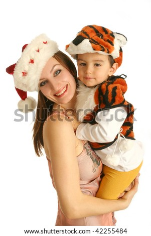 Mother in Christmas cap  with baby in fancy dress in the form of tiger on white background