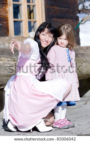 Mother in costume shows your child a little small /Mother and Child in costume - stock photo