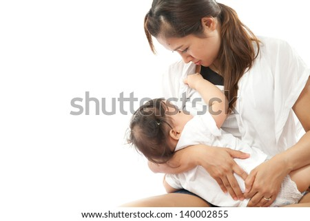 Mother is breast feeding for her baby - stock photo