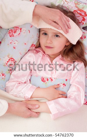 Mother is caring about  ill daughter - stock photo