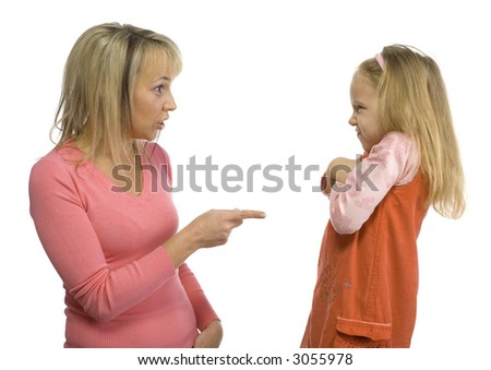 Mother is disciplining her 5-6yo daughter. Girl's looking rebellious. Side view. Isolated on white in studio. - stock photo