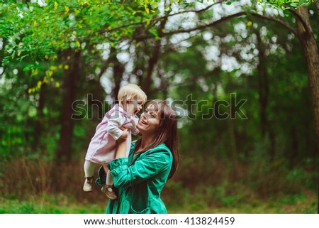 Mother is playing with her beloved daughter - stock photo