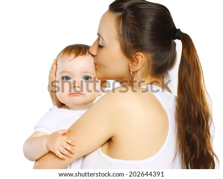 Mother kiss baby - stock photo