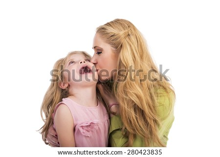 Mother kissing and playing with her lovely daughter over white  background - stock photo