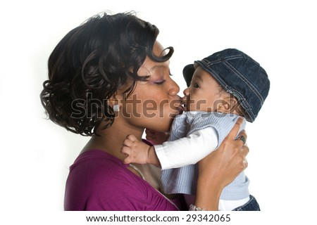 Mother Kissing Baby Boy - stock photo