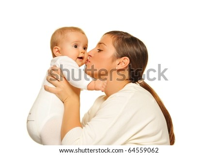 Mother kissing her baby - stock photo