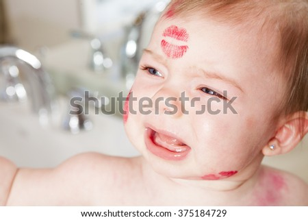 Mother kissing her baby, close up portraits - stock photo