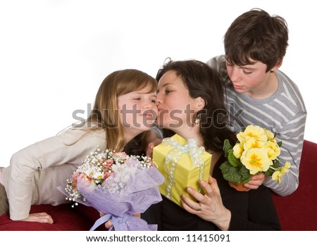 Mother kissing her daughter on mother's day - stock photo
