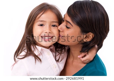 mother kissing her daughter's cheek, concept of family love - stock photo