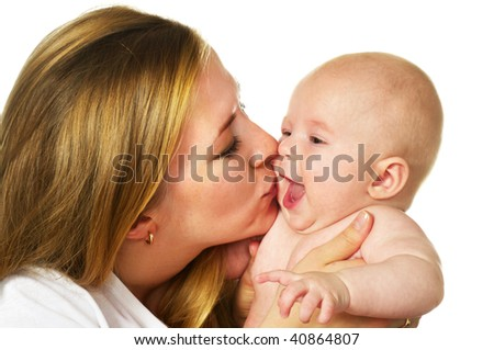 mother kissing her laughing baby boy; closeup faces