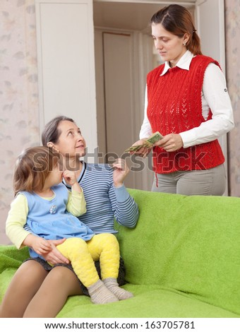 mother leaving baby with nanny at home - stock photo