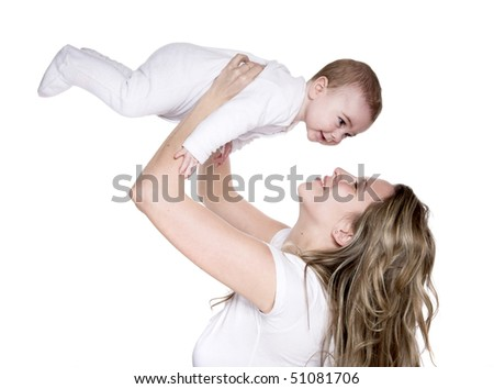 Mother lifts her beloved child up - stock photo