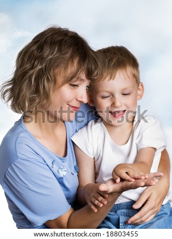 Mother, little son and a ladybird - stock photo