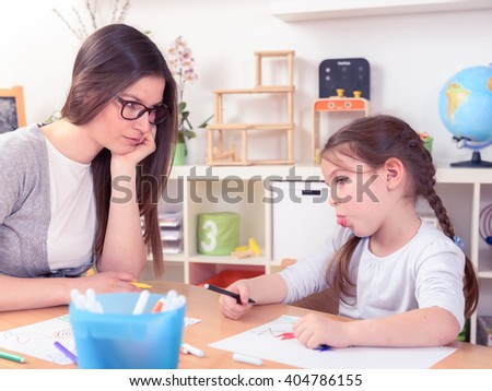 Mother Looking at Unhappy Kid Drawing at Home - stock photo