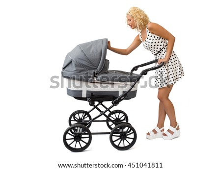 Mother looking into the baby carriage