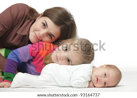Mother lying on the floor with her two kids - stock photo