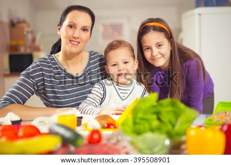 Mother making breakfast for her children in the morning