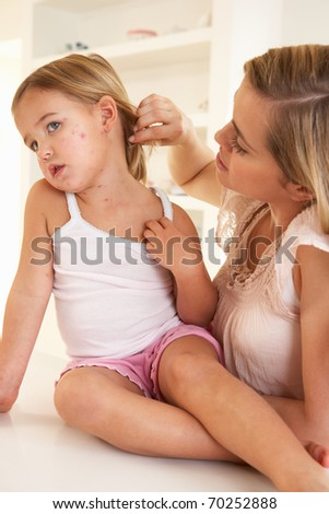 Mother nursing sick child