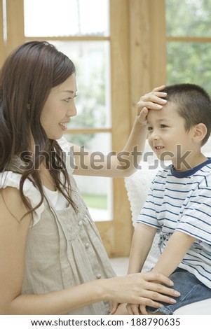 mother patting son on the head