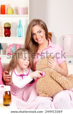 Mother playing nursing with child - stock photo
