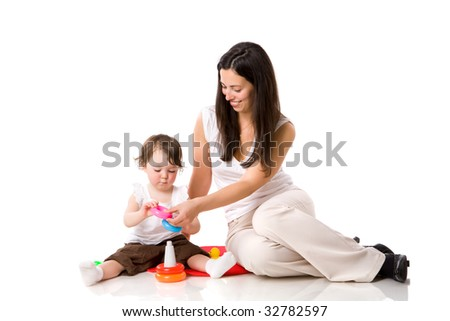 Mother playing with child holding pyramid isolated on white - stock photo