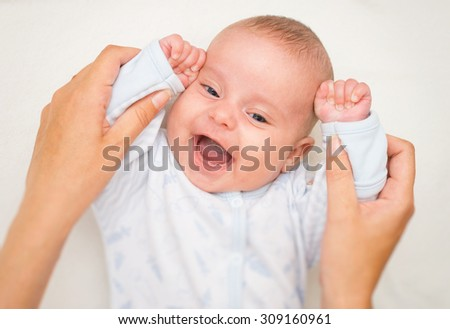 Mother playing with cute little baby. - stock photo
