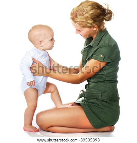 mother playing with her baby boy - stock photo